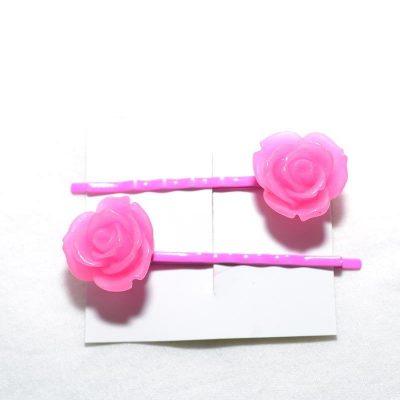 Pince à cheveux rose givrée rose